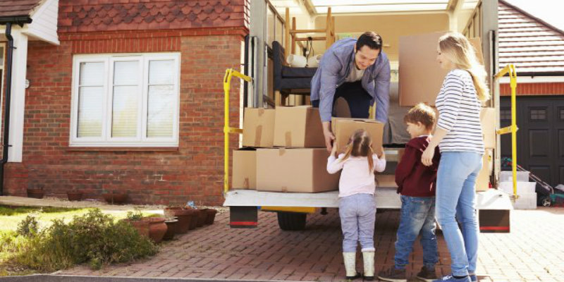 happy family loading a moving truck