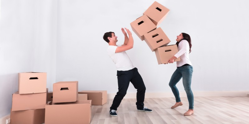 man and woman carrying packing boxes in hand