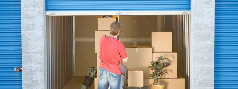 A person is storing his household into a storage unit