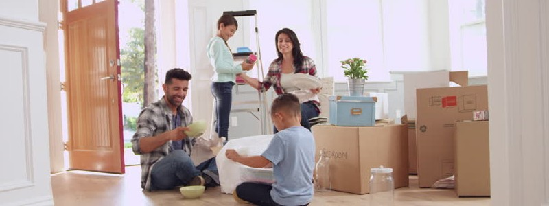 entire family packing their house for a relocation