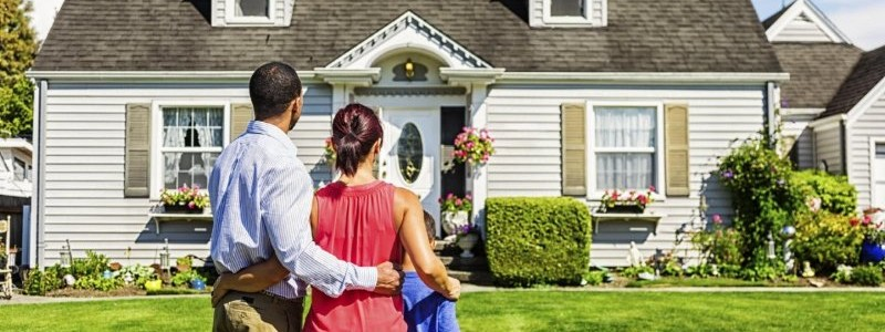 entire family inspecting a new house before buying