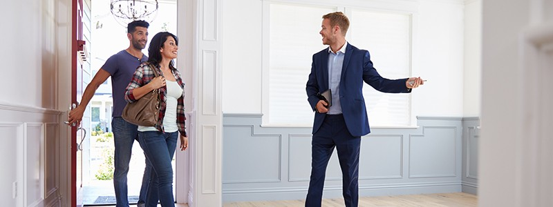 young couple inspecting a new house before buying it