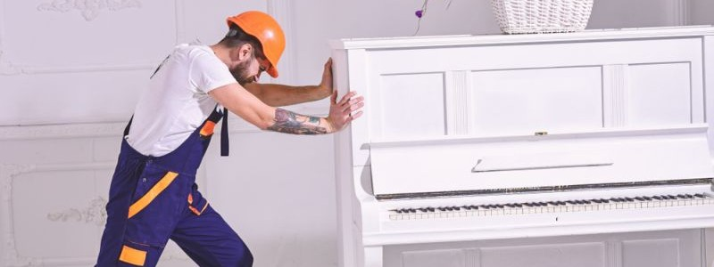 professional trying to move a piano