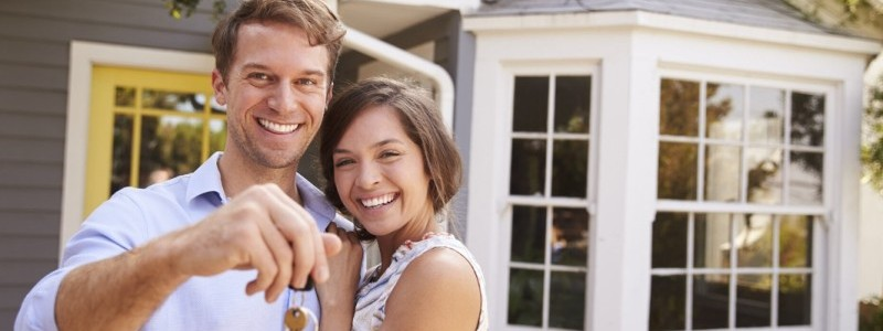 a couple with the keys of their new house
