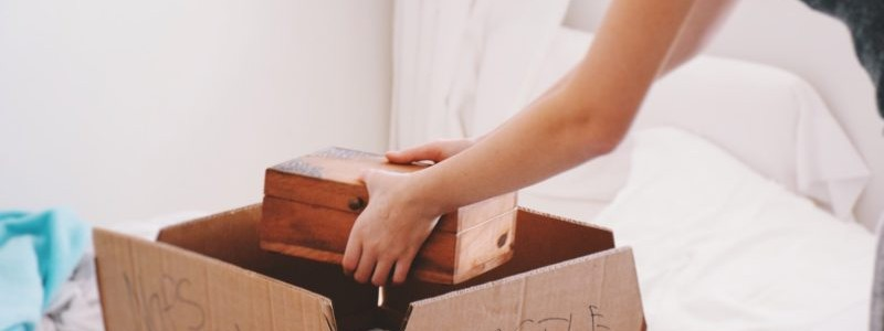 cropped picture of a woman packing important items for a relocation